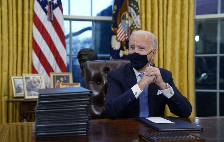 (Evan Vucci | AP) President Joe Biden waits to sign his first executive order in the Oval Office of the White House on Wednesday, Jan. 20, 2021, in Washington. An order starting the restoration of original boundaries to Bears Ears National Monument and Grand Staircase-Escalante National Monument were expected to be among the initial orders signed.