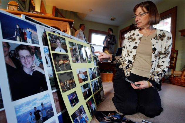 In this Dec. 9, 2011, file photo, Jane Clementi, right, the mother of Tyler Clementi, looks at family photographs in their home in Ridgewood, New Jersey. ((AP Photo/Mel Evans, File))