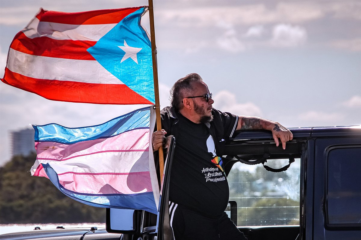 LGBTQ activist Justin Santiago, pictured here at a rally against gender violence on May 2nd in San Juan, Puerto Rico, after the death of Keishla Rodríguez Ortiz as well as other women who have been killed. Jose (Tito) Fuentes